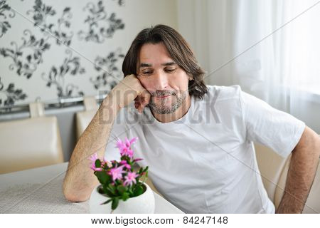 Man With A Pink Orchid In The Room