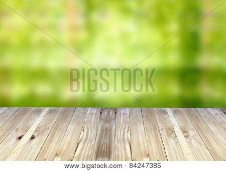 Broad Planks And Green Blur Background.