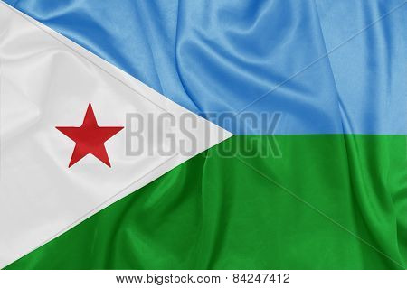 Djibouti - Waving national flag on silk texture