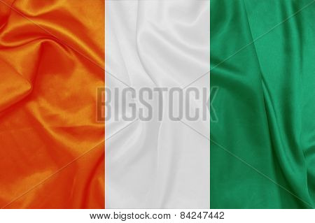 Ivory Coast - Waving national flag on silk texture
