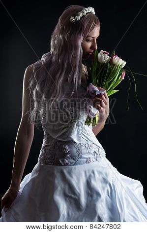 beautiful girl smelling a wedding bouquet of tulips