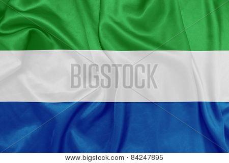 Sierra Leone - Waving national flag on silk texture