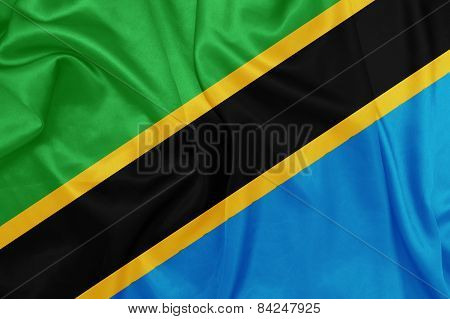 Tanzania - Waving national flag on silk texture