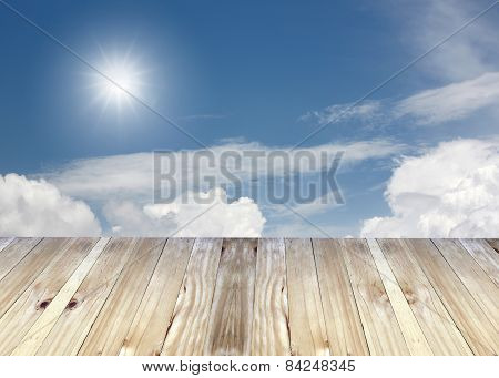Broad Planks And Blue Sky Of Blur Background.