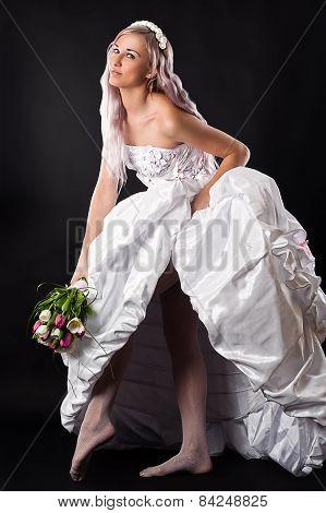 seductive beautiful bride in a wedding dress