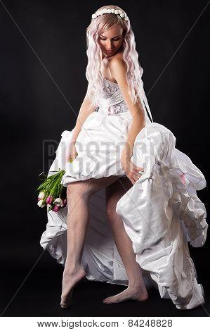 seductive beautiful woman in a wedding dress