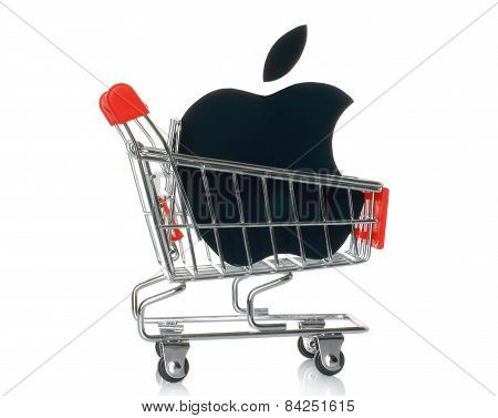 KIEV UKRAINE - JANUARY 16 2015: Apple logotype printed on paper and placed into shopping cart