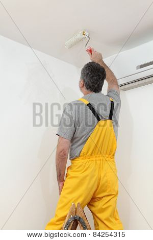 Worker Painting  In A Room, Home Renovation
