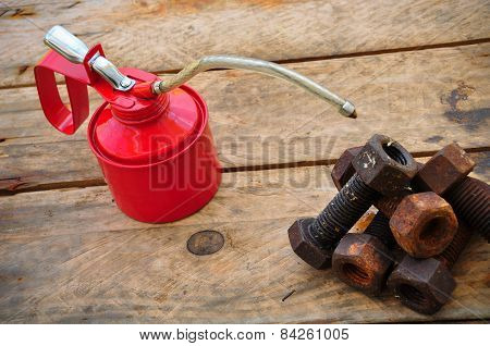 Oil can on wooden background, Lube oil can and used in industry or hard works.