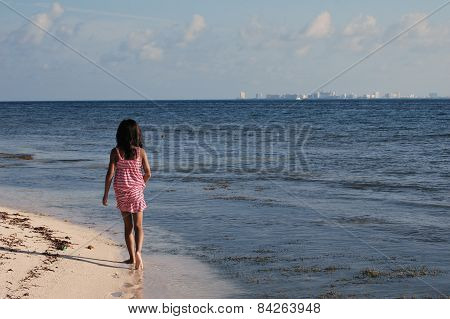 Girl Walking At The Beach