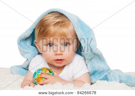 Baby boy holds small globe in his hands. Isolated on a white background.