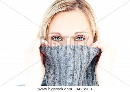 Delighted Woman Wearing A Polo-neck-sweater Smiling At The Camera