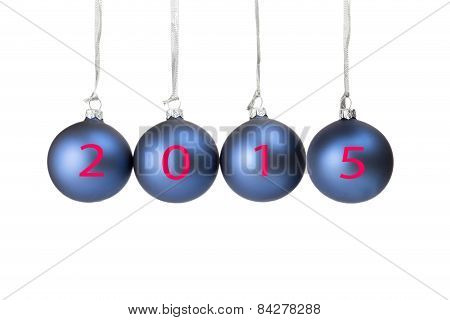 Four blue christmas balls with year 2015