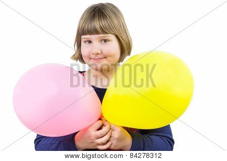 Young girl holding two balloons