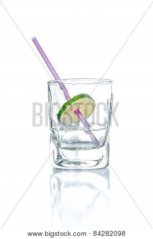 Vodka With Lime And Drinking Straw In A Glass Beaker, Isolated On White