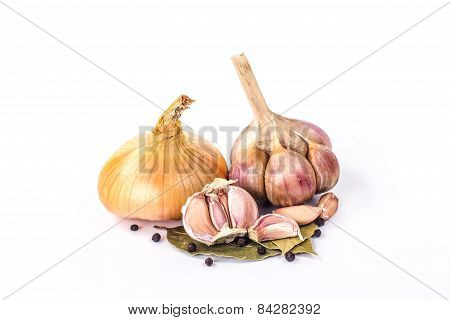 clove of garlic, bulb onion and bay leaves isolated