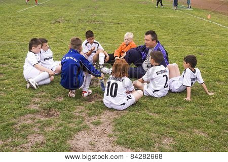 Trainer Discusses The Football Match With The Young Players