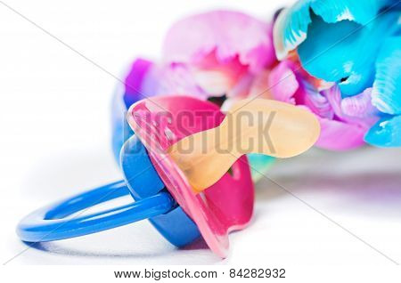 Pacifier with multicolored tulips