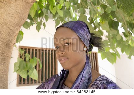 Young Afro beauty wearing a violet headscarf