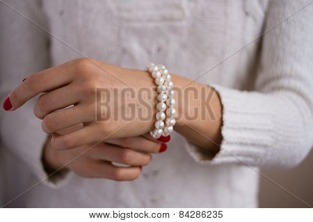 Pearl Bracelet On Her Arm