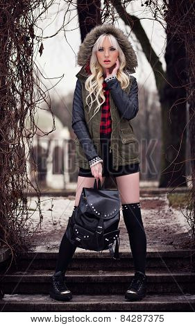 Fashion Girl With Backpack Outdoors