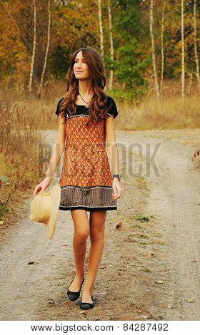Cute Young Woman In The Autumn Forest