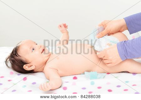 Mom Changing Diaper Her Little Baby Girl