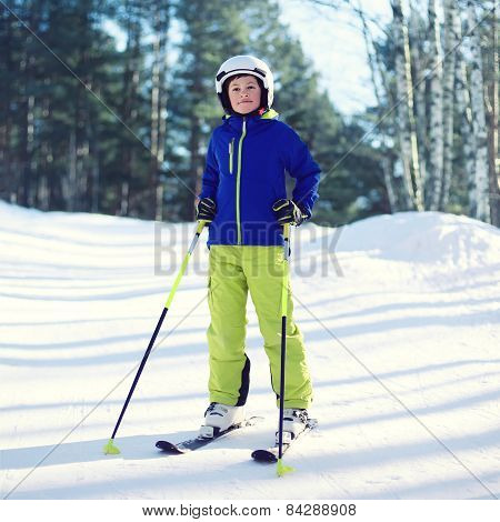 Professional Skier Boy In Sportswear And Helmet, Sunny Winter Day