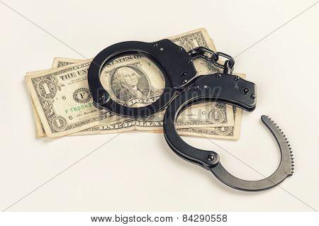 Criminal. Handcuffs On Money.
