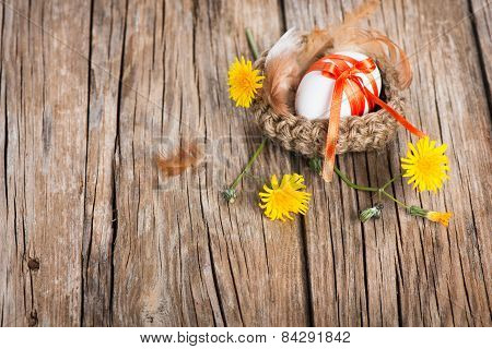 Nest With Easter Eggs And Yellow Flowers