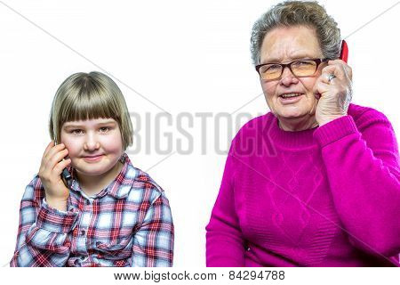 Grandmother and granddaughter phoning with mobile phone
