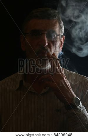 Senior man with cigarette