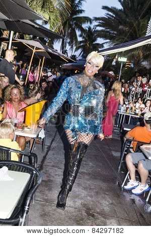 Transsexual Lady At Ocean Drive In Miami Gives A Performance On The Public Footpath