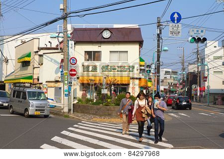 People Are Crossing The Street In Kamakura, Japan