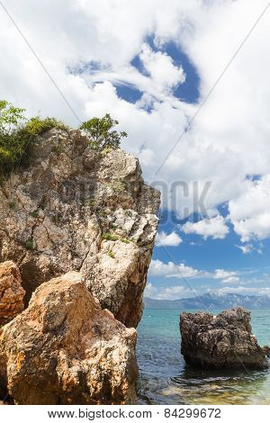 Seascape Of Adriatic Sea. Rocks In The Foreground.