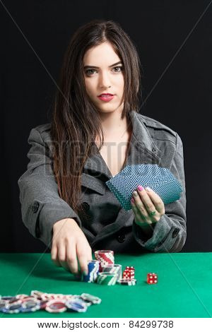 Beautiful lady playing Blackjack in casino