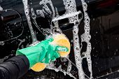 stock photo of car wash  - Outdoor car wash with yellow sponge - JPG