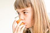 foto of inhalant  - Seven year old girl breathing asthmatic medicine healthcare inhaler - JPG