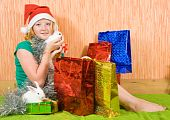 pic of tawdry  - teenager girl with Christmas gifts and two pet rabbits - JPG
