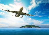 Passenger Plane Flying Over Beautiful Blue Ocean And Island In Purity Destination Sea Beach Use For poster