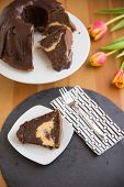 stock photo of lice  - Chocolate Sponge Cake with cream cheese filling - JPG