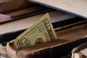 foto of twenty dollars  - twenty dollars in an old book money background - JPG
