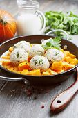 image of saucepan  - Baked pumpkin and chicken meatballs with herbs in a saucepan - JPG