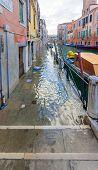 stock photo of flood  - A Flooded street in Cannaregio Venice Veneto - JPG