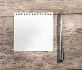 Постер, плакат: Note Pad Or Memo Pad On An Old Grungy Wooden Board Or Surface