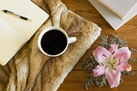stock photo of office romance  - Wooden desk with a cup of coffee - JPG