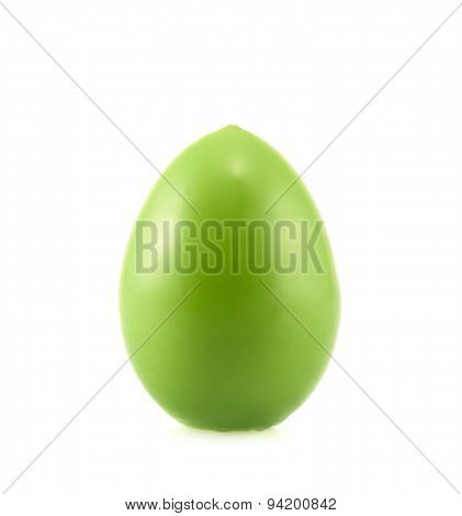 Egg shaped wax candle isolated