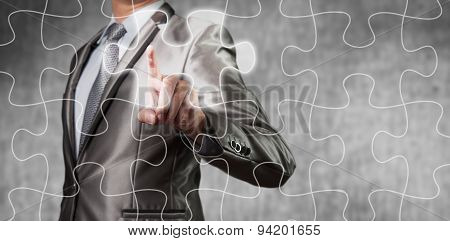 Businessman Using Tablet Showing Jigsaw Piece, Business Decision Concept