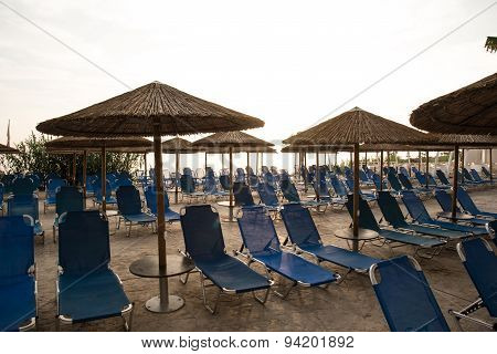 Empty Sun Beds At Hotel Swimming Pool