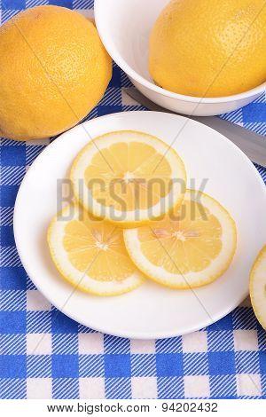 Fresh Juicy Sliced Lemon On A Ceramic Plate.